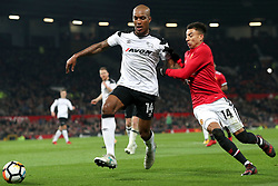 5 January 2018 - FA Cup (3rd Round) Football - Manchester United v Derby County - Andre Wisdom of Derby and Jesse Lingered of Man Utd battle for the ball - Photo: Charlotte Wilson / Offside