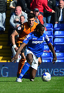 Clayton Donaldson shields the ball during the Sky Bet Championship match between Birmingham City and Wolverhampton Wanderers at St Andrews, Birmingham, England on 11 April 2015. Photo by Alan Franklin.