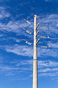 electricity power pole with insulators against cloudy sky <br /> <br /> Editions:- Open Edition Print / Stock Image