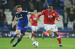 Jonathan Kodjia of Bristol City jostles for the ball with Aron Gunnarsson of Cardiff City - Mandatory byline: Dougie Allward/JMP - 07966 386802 - 26/10/2015 - FOOTBALL - Cardiff City Stadium - Cardiff, Wales - Cardiff City v Bristol City - Sky Bet Championship