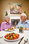 Retired Couple Enjoying Dinner with Friends