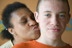 Teenage boy with his mother,