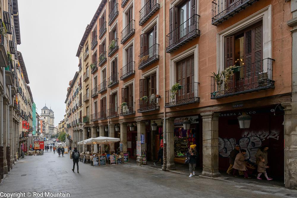 Madrid, Spain - February 15, 2018 - Pedestrians walk along Calle de Toledo near Plaza Mayor in Madrid, Spain.<br /> <br /> Image: © Rod Mountain http://www.rodmountain.com <br /> http://bit.ly/Madrid_bw<br /> Nikon D800 / Nikkor Lens <br /> <br /> @spain @visita_madrid <br /> <br /> @spain.info @visitamadridoficial <br /> <br /> @spain @Visita_Madrid @TurismoMadrid<br /> <br /> https://es.wikipedia.org/wiki/Calle_de_Toledo<br /> https://en.wikipedia.org/wiki/Madrid<br /> https://en.wikipedia.org/wiki/Portal:Madrid<br /> https://www.spain.info/en/<br /> <br /> #traveling #backpacking #TravelPhotoGallery #IamATraveler #Wonderful_Places #letsgosomewhere #touring #instago #mytravelgram #sharetravelpics #bw #bwphotography #insta_noir #bwsquare #bnw_madrid #enblancoynegro #monochrome #bwoftheday #bw_lover #irox_bw #Spain #TourismSpain #VisitSpain #wonderlust.spain #spain🇪🇸 #passionpassport #lifeofadventure #stayandwander #cityview #travelphotographer