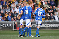 Ryan Taylor of Portsmouth celebrates scoring his side's first goal fromt he penalty spot with team-mates. Skybet football league two match, Newport county v Portsmouth at Rodney Parade in Newport, South Wales on Saturday 29th March 2014.<br /> pic by Mark Hawkins, Andrew Orchard sports photography.