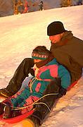 Sledding on a great winter day. St Paul Minnesota USA