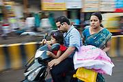 Family riding a motorbike in Varanasi in India.