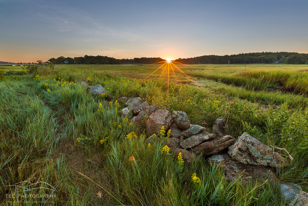 Sunrise over the salt marsh along the Essex River at the Cox Reservation in Essex, Maassachusetts.