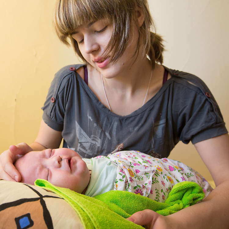 CAPTION: Nina admires her baby's new look, delighted with the result of the surgery. LOCATION: Volgograd City Hospital #1, Volgograd, Russia. INDIVIDUAL(S) PHOTOGRAPHED: Nina Panteleeyeva (above) and Valentina Panteleeyeva (below).