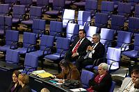 17 OCT 2003, BERLIN/GERMANY:<br /> Gerhard Schroeder (L), SPD, Bundeskanzler, und Jann-Peter Janssen (R), MdB, SPD, sitzen in den hinteren Reihen der SPD-Fraktion, waehrend einer Bundestagsdebatte, Plenum, Deutscher Bundestag<br /> IMAGE: 20031017-01-013<br /> KEYWORDS: Gerhard Schröder, Gespraech, Gespräch