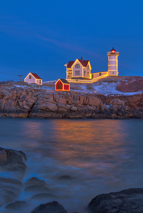 Cape Neddick Lighthouse with Christmas Decoration taken at sunset in York, Maine. Loved watching this sunset burst into colors and capturing the Christmas Lights while the last light of the day created a beautiful sky across one of Maine's most iconic Christmas light scenes.<br /> <br /> Maine Cape Neddick Lighthouse fine art photography is available as museum quality photography prints, canvas prints, acrylic prints or metal prints. Prints may be framed and matted to the individual liking and room decor needs:<br /> <br /> https://juergen-roth.pixels.com/featured/nubble-lighthouse-with-holidays-decoration-juergen-roth.html<br /> <br /> My best,<br /> <br /> Juergen<br /> Prints: http://www.rothgalleries.com<br /> Photo Blog: http://whereintheworldisjuergen.blogspot.com<br /> Instagram: https://www.instagram.com/rothgalleries<br /> Twitter: https://twitter.com/naturefineart<br /> Facebook: https://www.facebook.com/naturefineart
