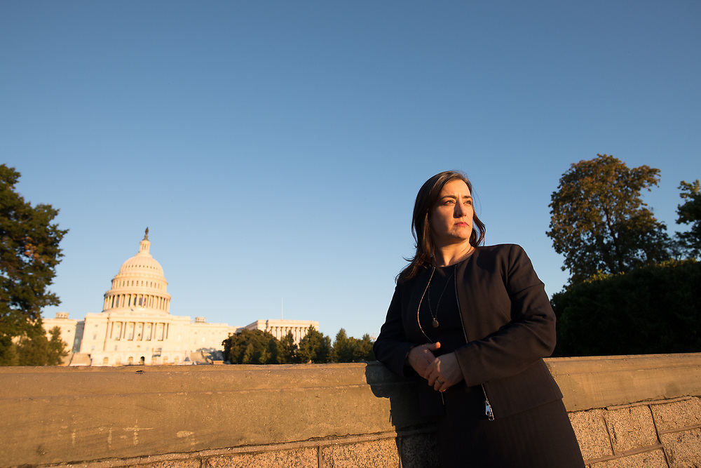 Marni Hall a covid researcher photographed in front of the U.S. Capitol Building by Jeff Mauritzen for WPI Journal.
