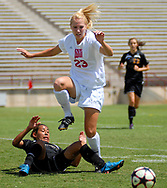 Robin Zielinski/Sun-News<br /> New Mexico State Universitys Baili Foutz nearly steps on Yosselyn Aguliar from Prairie View A&M as she attacks the ball during Sunday's game at NMSU.