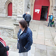 Jane from Find and Treat outside the MXU van talking to a woman about TB. The woman had an x-ray and showed no sign of TB. The NHS Mobile X-ray Unit visiting St Pauls Church drop-in  in Onslow Square, London SW7.