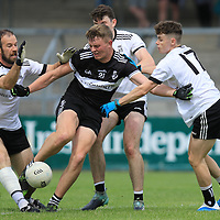 Doonbeg's Kevin McInerney is surrounded by the Ennistymon defense