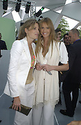 Jemima Khan and Elle Macpherson. Serpentine Gallery Summer party in a glass and steel pavilion designed by Toyo Ito and Arup. . tuesday 9 July 2002. © Copyright Photograph by Dafydd Jones 66 Stockwell Park Rd. London SW9 0DA Tel 020 7733 0108 www.dafjones.com