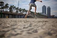 BARCELONA, SPAIN: Children playing football on the beach in Barcelona, Spain.