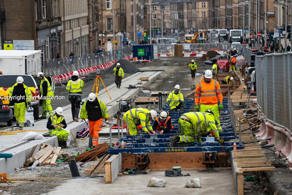 Construction workers laying tracks for new Edinburgh Tram project on Leith Walk, Edinburgh, Scotland, UK
