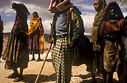 People wearing traditional clothes on the road to  Harar, Situated in Eastern Ethiopia it is considered to be the fourth  holiest city in Islam with 82 mosques. It is a major commercial centre linked by trade routes with the rest of Ethiopia and the entire Horn of Africa.  Ethiopia