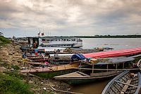 NAUTA, PERU - CIRCA OCTOBER 2015:  Boats in the port of Nauta in the Peruvian Amazon.