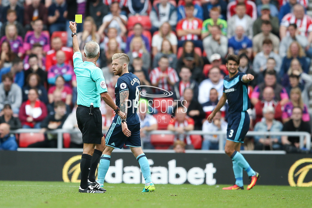 Middlesbrough midfielder Adam Clayton (8) is booked and receives a caution and a yellow card from todays referee Martin Atkinson  during the Premier League match between Sunderland and Middlesbrough at the Stadium Of Light, Sunderland, England on 21 August 2016. Photo by Simon Davies.