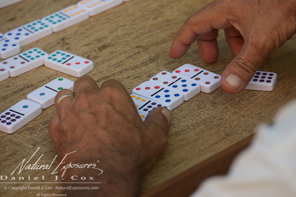 Playing Cuban Dominos on the streets of Trinidad, Cuba.