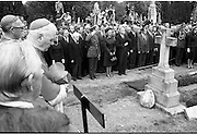 Funeral of Eamon DeValera.   (J72)..1975..02.09.1975..09.02.1975..2nd September 1975..Today saw the funeral of Eamon DeValera. He was laid to rest beside his wife Sinead in Glasnevin Cemetery,Dublin. Dignitries from all around the world attended at the funeral..Image of Mr Liam Cosgrave,leader of Government his wife Vera and members of Dail Eireann line the graveside for the playing of the National Anthem.