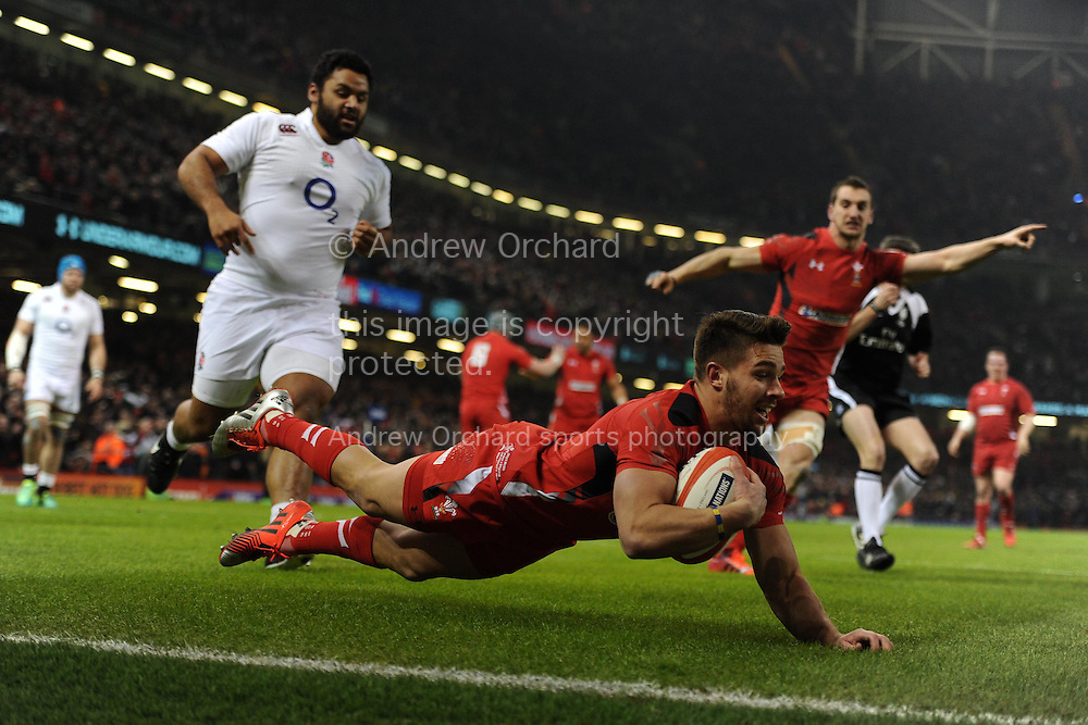 Rhys Webb of Wales dives over to score the 1st try.  RBS Six nations championship 2015, Wales v England at the Millennium Stadium in Cardiff, South Wales on Friday 6th  Feb 2015. pic by Andrew Orchard, Andrew Orchard sports photography.