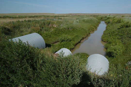 Irrigation ditch on ranchland. Montana.