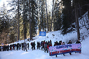 The third and last day of the Strike WEF march on Davos on 21st of January 2020 in Davos, Switzerland. The authorities had refused permission for the march to walk on the road into Davos so many hiked across the mountains from Klosters to get there. The march is a three day protest against the World Economic Forum meeting in Davos. The activists want climate justice and think that The WEF is for the worlds richest and political elite only.