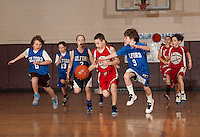 Karter Greenwood guarded by Riley Marsh during the Coed junior division championship action between Lou Athanas Laconia and Gilford in the 20th annual Francoeur Babcock Basketball Tournament on Sunday.  (Karen Bobotas/for the Laconia Daily Sun)
