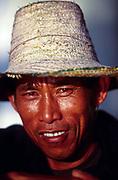 A Thai fisherman on a beach on the Thai island of Koh Pangan, Thailand