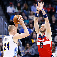 08 March 2017: Denver Nuggets center Mason Plumlee (24) looks to pass the ball over Washington Wizards center Marcin Gortat (13) during the Washington Wizards 123-113 victory over the Denver Nuggets, at the Pepsi Center, Denver, Colorado, USA.