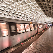 A train arrives at one of the distinctive domed stations of the Washington Metropolitan Area Transit Authority subway system in the Washington DC area. This station is in Ballston, Arlington, a few stops out from downtown Washington DC.