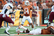 AUSTIN, TX - AUGUST 31: David Ash #14 of the University of Texas Longhorns throws a pass against the New Mexico State Aggies on August 31, 2013 at Darrell K Royal-Texas Memorial Stadium in Austin, Texas.  (Photo by Cooper Neill/Getty Images) *** Local Caption *** David Ash