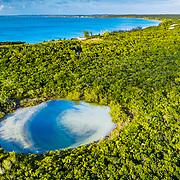 An aerial view of a blue hole on Eleuthera Island, Bahamas.