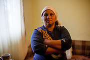 Portrait of mother Gabriela Costache (37) in the living room of her family in Marginenii de Jos.