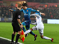 Football - 2017 / 2018 Premier League - Swansea City vs. Arsenal<br /> <br /> Martin Olsson of Swansea City pushes  Hector Bellerín of Arsenal into touch in front of the linesman , at The Liberty Stadium.<br /> <br /> COLORSPORT/WINSTON BYNORTH