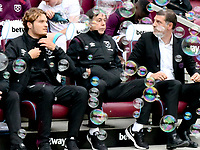Football - 2017 / 2018 Premier League - West Ham United vs. Swansea City<br /> <br /> West Ham manager Slaven Bilic on the bench surrounded by bubbles, at The London Stadium.<br /> <br /> COLORSPORT/WINSTON BYNORTH