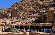 """Tourist resting in area with food, drink and souvenirs, in the """"main street"""" area of Petra, which was recently named one of the """"Seven Modern Wonders of the World"""" - Jordan."""