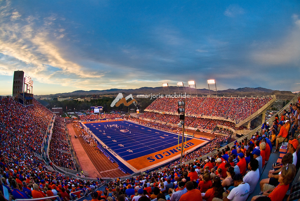 Boise State University football game at sunset with the foothills beyond. Idaho.