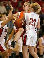 S.S. Seward's Vivien Greiser, center, is fouled while trying to drive between Hammond's Cassie Cunningham (21) and Katlyn Hunt, right, in the Class D state championship game at Hudson Valley Community College in Troy on March 18, 2007.