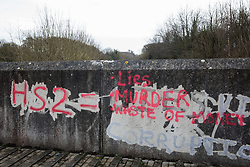 Wendover, UK. 20th February, 2021. Anti-HS2 graffiti on a wall close to woodland which is currently being cleared for the HS2 high-speed rail link. Anti-HS2 activists continue to occupy the Wendover Active Resistance Camp on the opposite side of the rail line from the woodland.