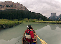 BRADLY J. BONER / NEWS&GUIDE <br /> Squaretop Mountain is reflected in the waters of the Green River as a canoeist navigates the waterway above Upper Green River Lake recently in the Wind River Mountains.