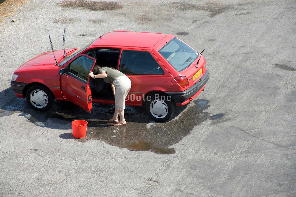 woman washing her little car France