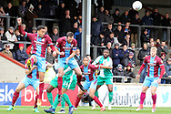 Scunthorpe United defender James Perch (14) and Scunthorpe United defender Rory McArdle (23) clear the ball  during the EFL Sky Bet League 1 match between Scunthorpe United and Plymouth Argyle at Glanford Park, Scunthorpe, England on 27 October 2018. Pic Mick Atkins