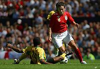 Photo: Paul Thomas.<br /> England v Jamaica. International Friendly. 03/06/2006.<br /> <br /> Frank Lampard of England (R) gets past Garfield Reid.