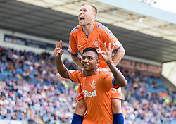 Rangers Alfredo Morelos (bottom) celebrates scoring his side's first goal of the game with Scott Arfield during the Betfed Cup Second Round match at Rugby Park, Kilmarnock.