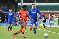Wycombe Wanderers Forward Adebayo Akinfenwa (20) and AFC Wimbledon Forward Joe Pigott (39) during the EFL Sky Bet League 1 match between AFC Wimbledon and Wycombe Wanderers at the Cherry Red Records Stadium, Kingston, England on 27 April 2019.