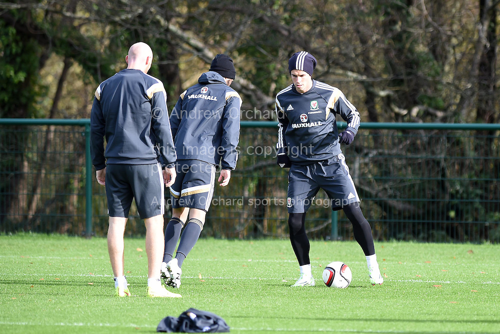 Gareth Bale of Wales (r) during Wales football squad training at the Vale Resort, Hensol, near Cardiff , South Wales onWed 12th November 2014. The team are training ahead of their Euro 2016 qualifying match against Belgium on the weekend.  <br /> pic by Andrew Orchard, Andrew Orchard sports photography.