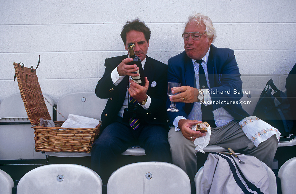 Gentlemen fans of cricket enjoy drinks and a day out during the test match between England and New Zealand on 21st August 1999, at the Oval ground, south London, England.